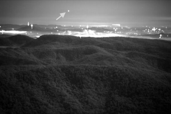 The unexplained ball of light hovering above Brown Mountain stands apart from the lights of Lenoir.