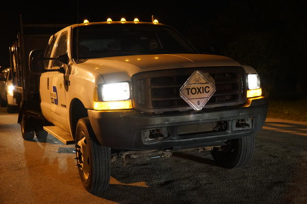 Miami-Dade County trucks transportind the insecticide to be used in aerial spraying over Miami Beach.