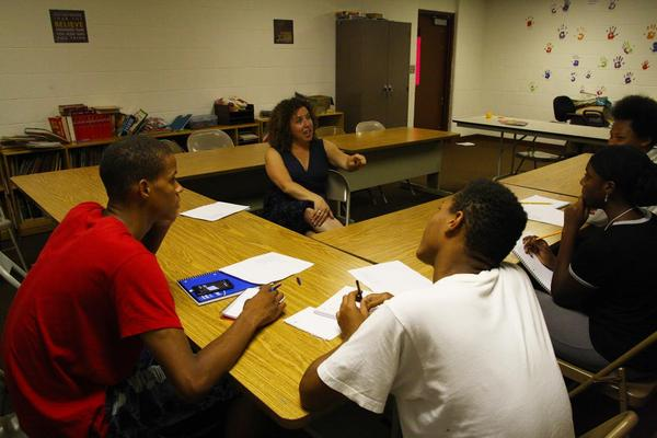Lynne Golodner works with teens in a summer workshop at the Samaritas Community Center in Saginaw.