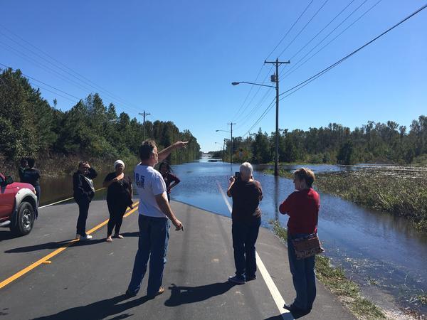 Flooding along NC 211 near Lumberton makes the road impassable for motorists on Monday, October 10, 2016.