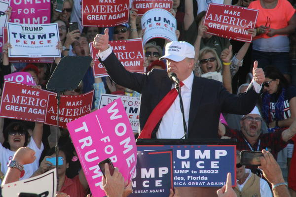 Trump speaks to supporters at a rally in Naples.