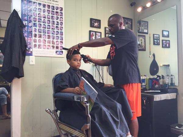 At The Fuller Cut in Ypsilanti, kids who read to their barber get $2 off their haircut