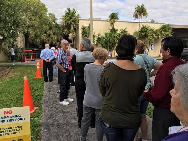 Voters in line at Kendall Branch Library in Miami, FL.
