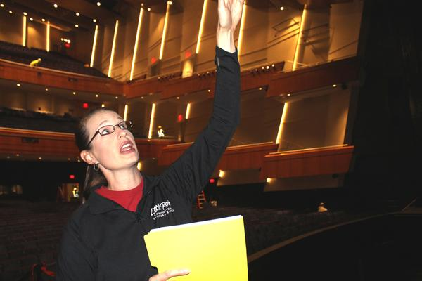 Gretchen Hall, president and CEO of the Little Rock Convention and Visitors Bureau, pointing out features of the newly renovated auditorium.