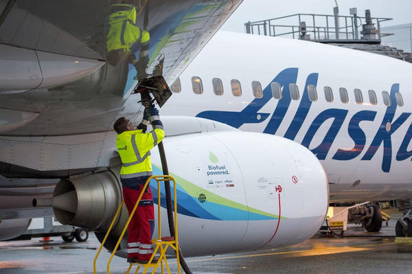 Swissport fuel manager Jarid Svraka fuels an Alaska Airlines flight powered with a 20 percent blend of biofuel made from forest residuals at Seattle-Tacoma International Airport on November 14, 2016.