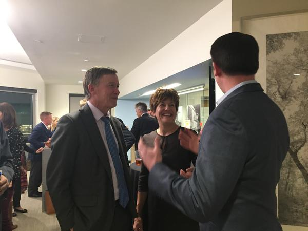 Governor Hickenlooper talks to Kelly Brough, the head of the Denver Metro Chamber of Commerce on election night