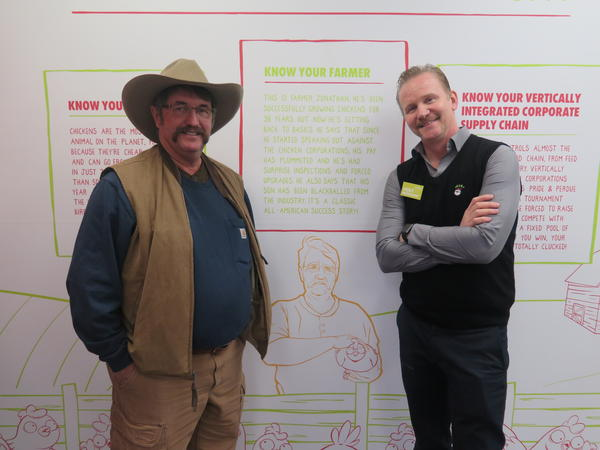 Alabama farmer Jonathan Buttram and documentary filmmaker and Holy Chicken founder Morgan Spurlock pose for a photo.