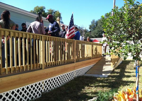The backyard deck is at the same level as the indoor floors and has a ramp making it wheelchair accessible.