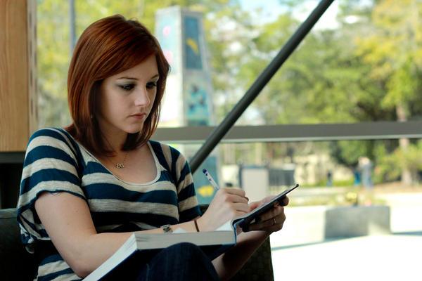 A UWF student studies on campus.