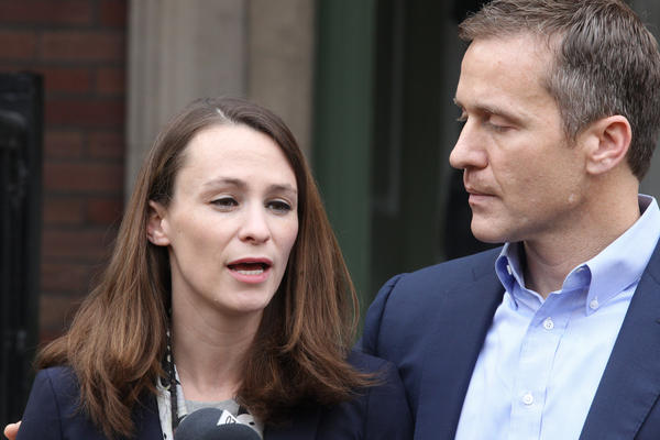 Missouri Governor-elect Eric Greitens listens as wife Sheena talks about her expirence of being robbed to reporters in St. Louis.