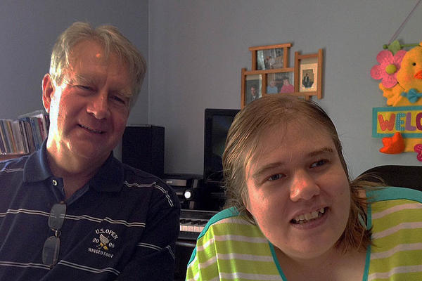 Betsy Irish with her father, David Irish, at her group residence in a suburb of Rochester.