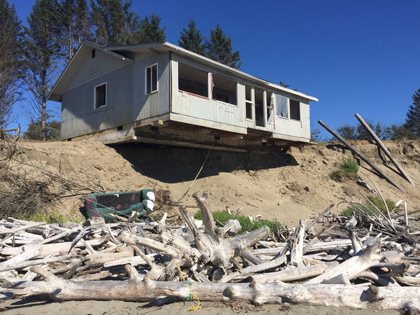 This will probably be the next in a long series of homes to fall into the sea at Washaway Beach, Washington.