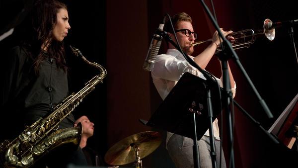 Tenor saxophonist Melissa Aldana performs with trumpet player Philip Dizack.