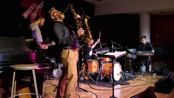 Jim Black's Malamute (Óskar Guðjónsson, tenor sax; Chris Tordini, electric bass; Jim Black, drums; Elias Stemeseder, keyboard) performs at Winter Jazzfest.