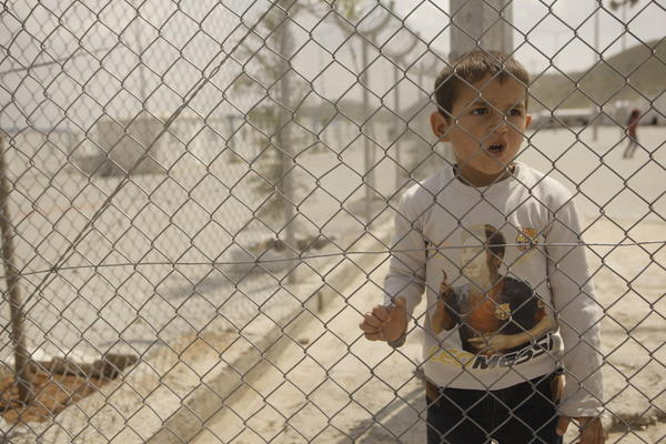 A boy in a refugee camp in Turkey. A family of Iraqi Christians are currently waiting in Turkey. They were supposed to be resettling in Michigan in the next few days.