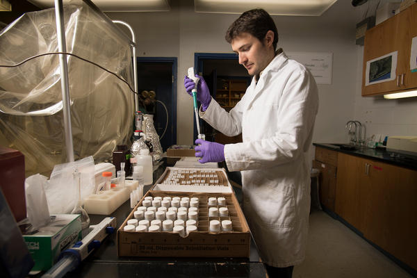 Postdoctoral Research Associate Florian Cesbron, PhD, takes a phosphate analysis of water samples collected in domes at the University of West Florida Thursday January 26, 2017 in Pensacola, Florida.