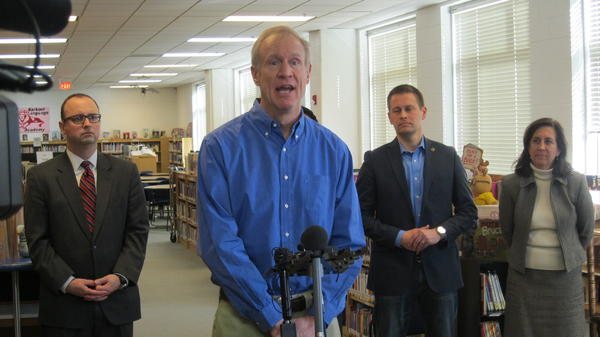 Gov. Rauner speaking in Barbour's library, accompanied by state Secretary of Education Beth Purvis.