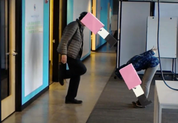 <p>The artists Kristin Lucas and William Pappenheimer try out the augmented reality flamingo heads, as seen through a HoloLens headset, that Lucas created during the Oregon Story Board research residency.</p>
