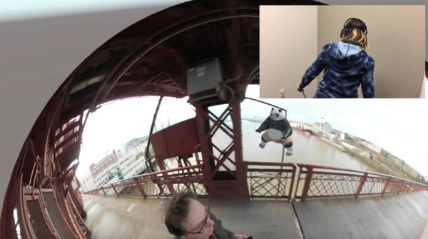 <p>Wearing an HTC Vive headset, Kristin Lucas (inset) looks into the 360 video that Brooklyn artist William Pappenheimer filmed walking across the Broadway Bridge (seen here as a 2D screenshot). She can fully move into the bubble, or explore one of the other 360 videos that Pappenheimer has placed nearby.</p>