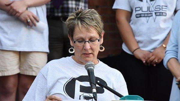 "Cindy Martsch, whose son is transgender, reads names at a Springfield memorial for victims of the Orlando mass shooting at Pulse nightclub.  Martsch told NPRIllinois she participated in the event  ""because  my son came home, and somebody else's didn't."""