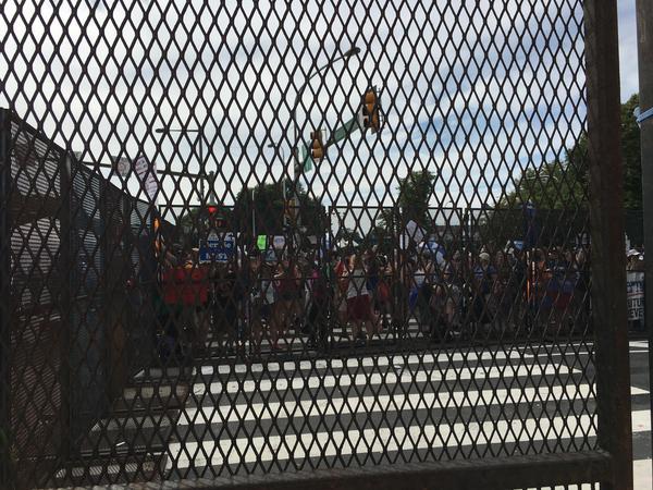 Demonstrators in the protest zone near Wells Fargo Arena.