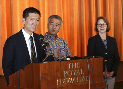 Hawaii attorney general Douglas Chin, from left, with Hawaii Gov. David Ige and Oregon attorney general Ellen Rosenblum, speaks at a press conference Wednesday, March 15, 2017, in Honolulu.
