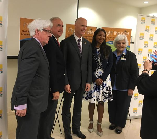 Gov. Rick Scott, third from left, and other community leaders at the roundtable to discuss Zika prevention methods for the upcoming rainy season.
