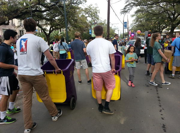 Volunteers for the organization Arc of Greater New Orleans collect leftover beads to resell.