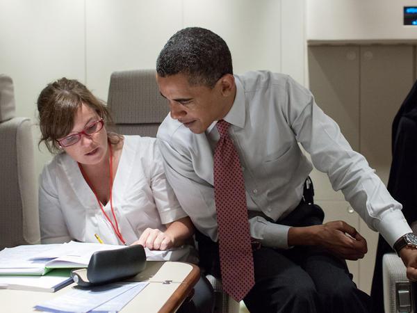 President Barack Obama confers with Alyssa Mastromonaco aboard Air Force One.