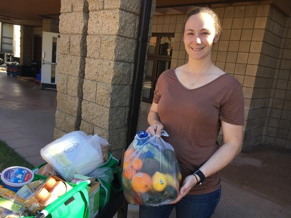 Kara Dethlefsen, an active-duty Marine, attends the monthly food pantry at the Camp Pendleton Marine Corps Base near San Diego. Her husband is also a Marine. She says the food assistance is helping them get ready for his transition back to civilian life. The couple has a 4-month-old daughter.