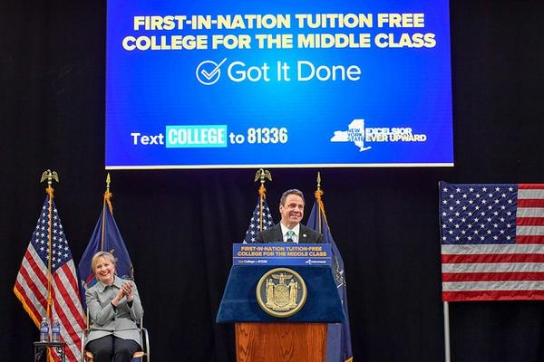 Governor Andrew M. Cuomo, along with former Secretary of State Hillary Clinton, signs legislation for tuition-free college for middle class students last week at LaGuardia Community College in Queens..