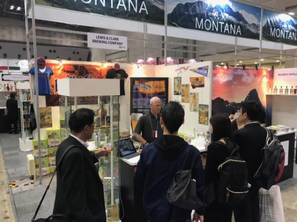 Garry Hicks from Lewis & Clark, giving samples at the trade show in Japan