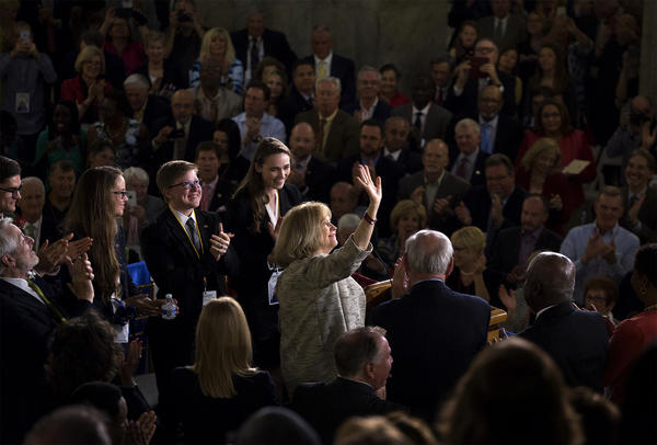 Lyda Krewson waves after taking the oath of office to become the 46th mayor of St. Louis.