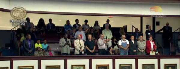 As part of a formal apology from the Florida House Tuesday, the former wards of the Dozier School for Boys stand as their names are called.