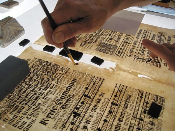 Repairing a 16th century compendium of ecclesiastical music at the University of Michigan Library conservation lab.
