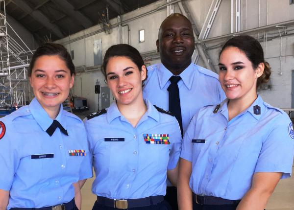 Retired MSgt. Kevin Gunter with three of his cadets from the Dunnellon High School Air Force Junior ROTC. Cadets left to right: Maggie Barde, Isabella Pierro and Natasha Pierro, twins.