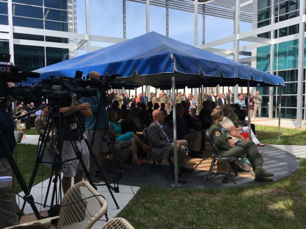More than 100 people crowded into the JSOU courtyard for the grand opening ceremony.