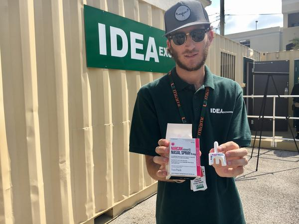 Carlos Padron, a research assistant at the IDEA Exchange Center, holds the overdose revival drug called Naloxone, commonly referred to as its brand name Narcan.
