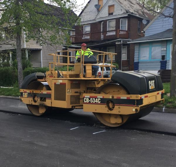 A Clevleand street repair crew working on one of the 83 residential street being fixed this year