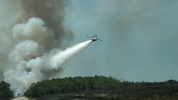 A Chinook helicopter battles an 1100-acre water tower brush fire in Hernando County on April 9th. The cause was lightning.