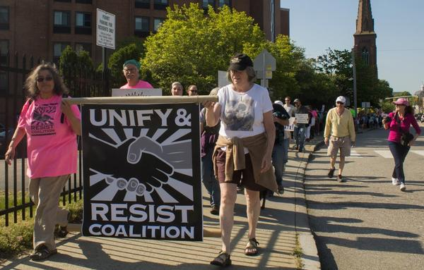 Anti-Trump protestors march from downtown New London to Soldiers and Sailors Memorial Park on Wednesday as President Trump delivered the commencement address at the Coast Guard Academy.