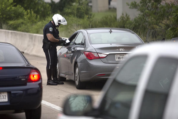 After receiving information from Austin police aboard the Cap Metro bus, this officer pulled over a driver suspected of driving while distracted. Austin's ordinance is far broader than the statewide bill banning texting while driving.