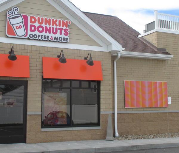 "Julian Stanczak's ""Dual Glare"" (1970) complements the orange branding of a Dunkin' Donuts on East Market Street in Akron."