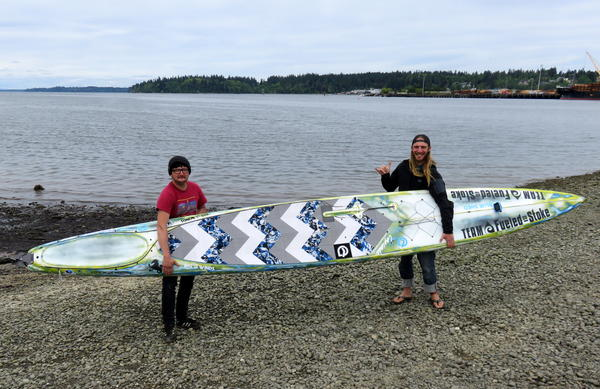 Erdogan Kirac, left, and Luke Burritt of Bellingham are planning to compete in the Race to Alaska on twin boards including this one.