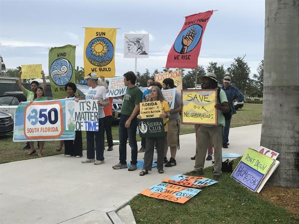 Protesters gathered in Miami's Museum Park on Thursday expressed anger over President Donald Trump's decision to withdraw the United States from the Paris climate accords.