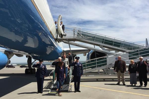 Vice President Mike Pence salutes as he leaves Air Force Two at the Billings airport. He's followed by U.S. Senator Steve Daines.