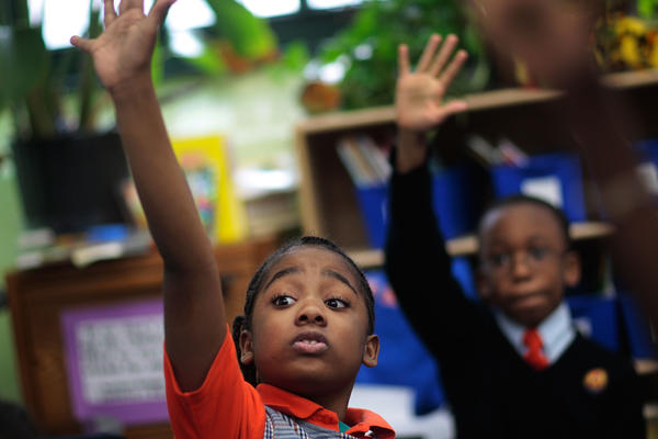 Third grade students raise their hands in reading comprehension class at Success Academy Harlem  in March 2009