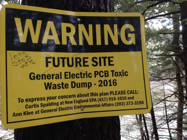 A warning sign posted by opponents to a proposed toxic waste disposal site in the woods, near the Housatonic River  in Great Barrington, Mass.