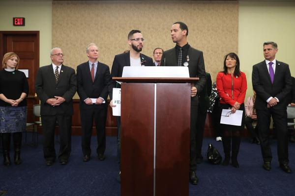 Angel Santiago and Luis Roldan, survivors from Pulse Nightclub shooting in Orlando, speak during a news conference with more than 80 family members and friends of people who were killed by gun violence and congressional Democrats to call for action on gun violence prevention at the U.S. Capitol, December 2016.