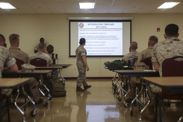 Major Misty Posey leads a 2016 class for Marine Corps leaders about integrating women into combat roles.